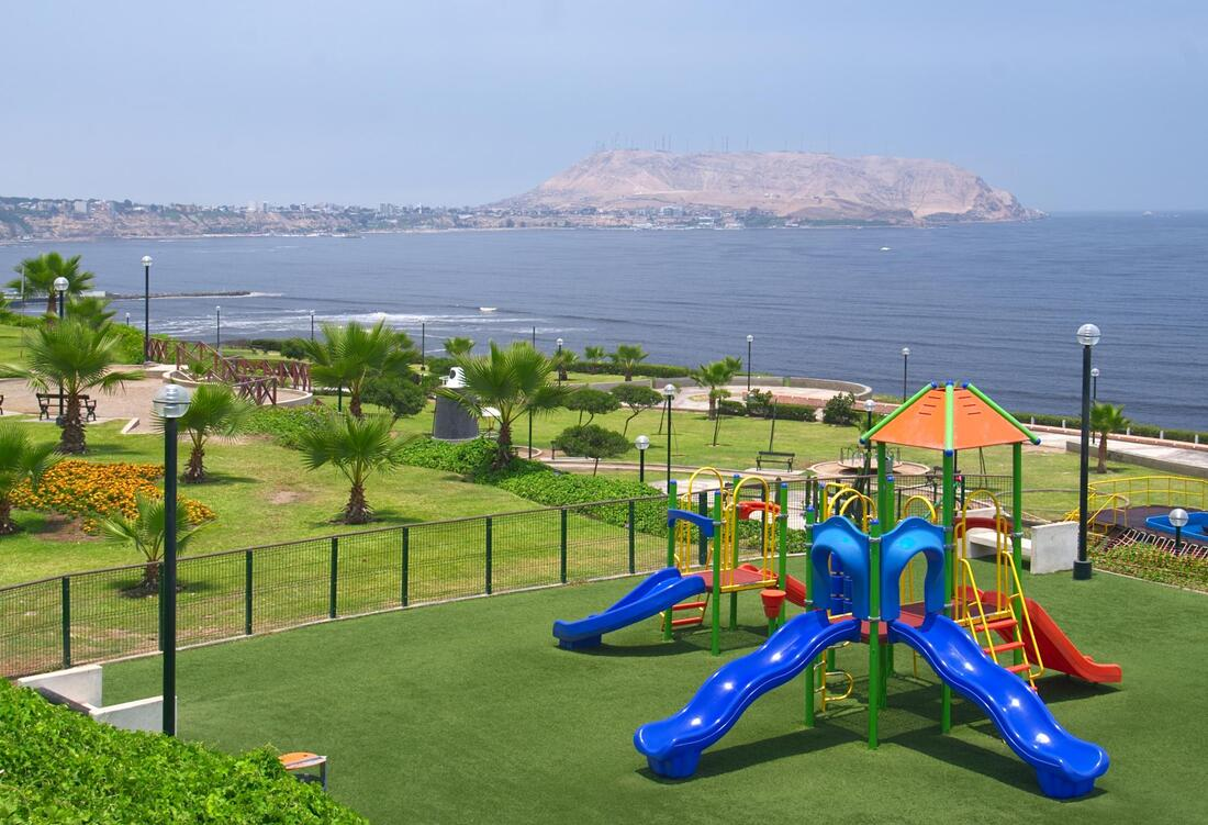 huge playground with fake grass near the sea